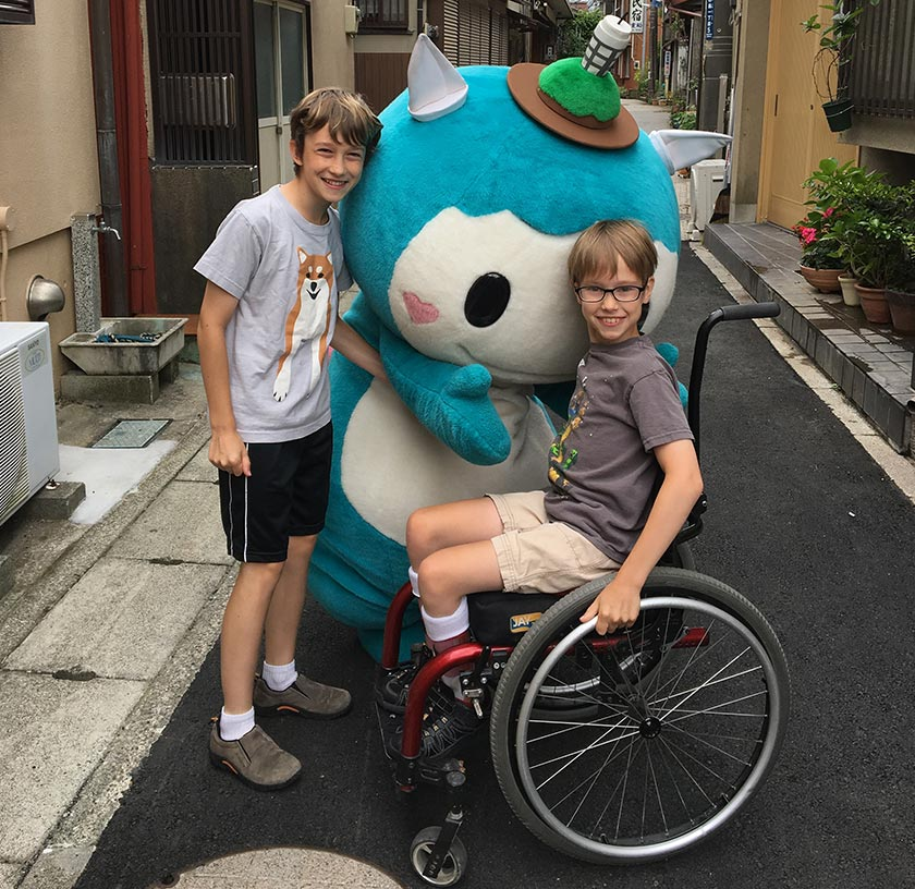 Dominick and Xander with a mascot character