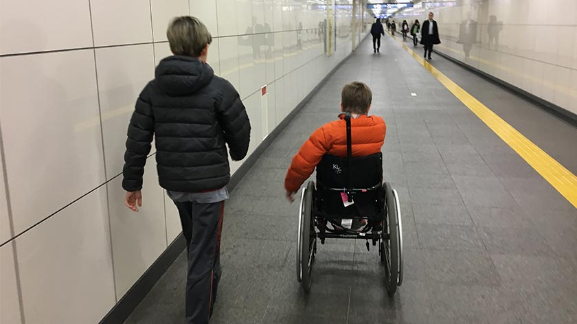Dominick and Xander at a train station in Japan
