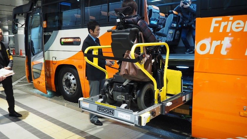 Accessible airport bus wheelchair user on lift