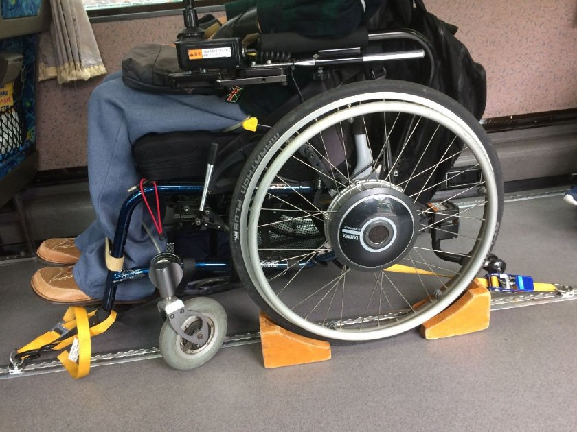Accessible airport bus wheelchair straps