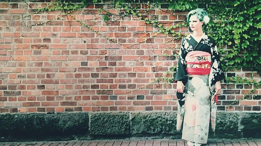 Alexa in a kimono by a wall