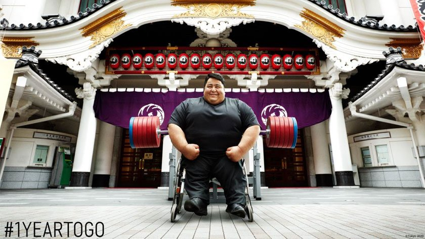 Paralympic Athlete Siamand Rahman in front of the Kabukiza Theater