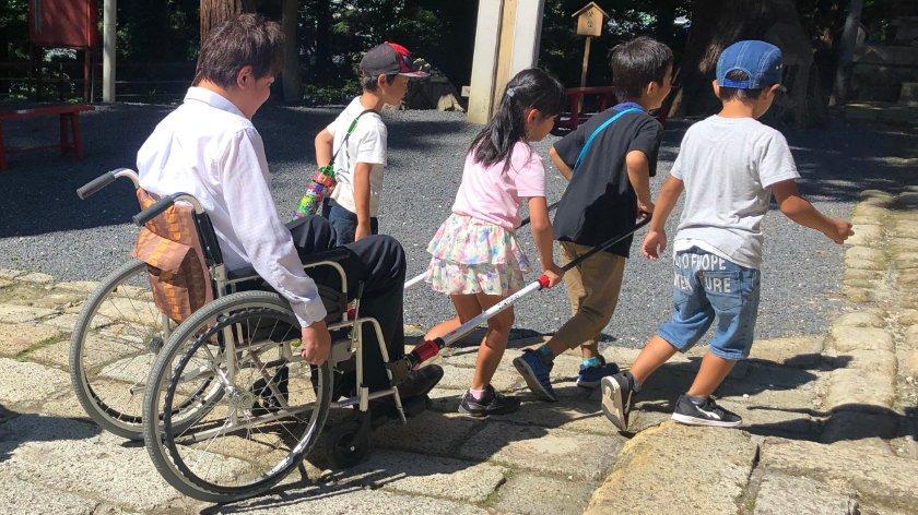 Children pullying Mr. Kato at Kumano Taisha